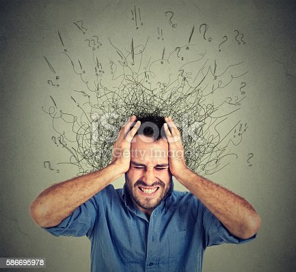 istock Stressed man has many thoughts brain melting into lines 586695978