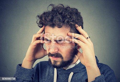 istock Stressed man having headache 926566738