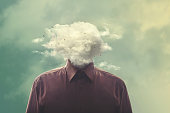 istock stressed man head in the cloud 862431374