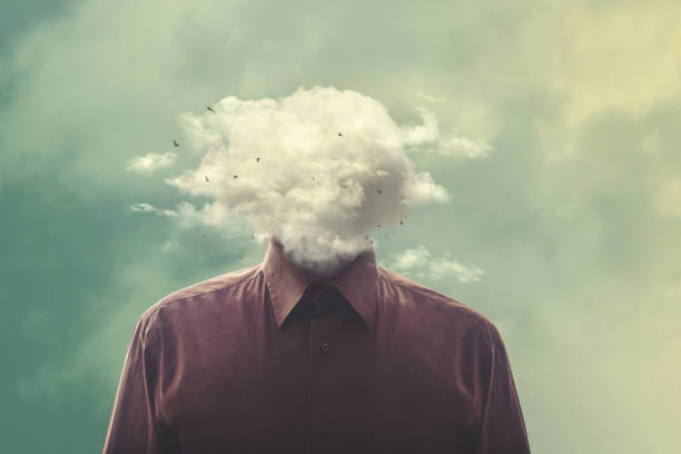 stressed man head in the cloud stock photo