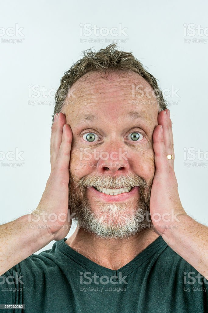 Stressed man in beard with crazy expression. royalty-free stock photo