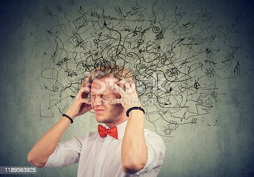 istock Stressed man with a mess and confusion in his head 1189563925