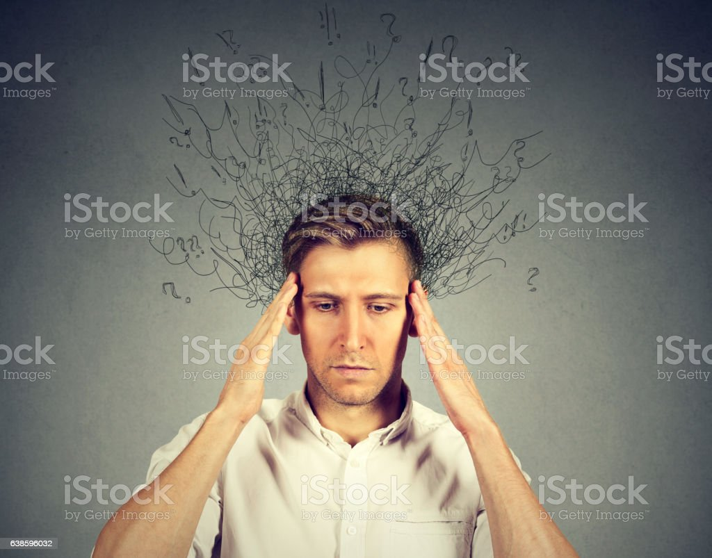 stressed man with brain melting into lines question marks stock photo