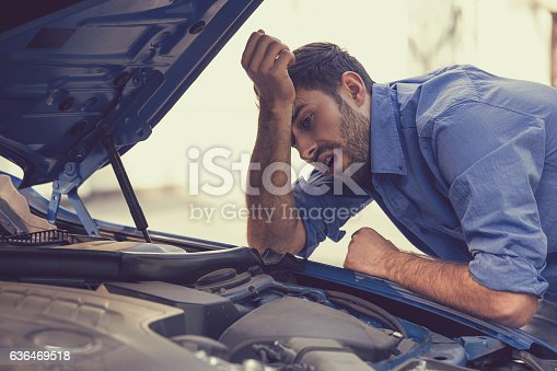 istock stressed man with broken car looking at failed engine 636469518