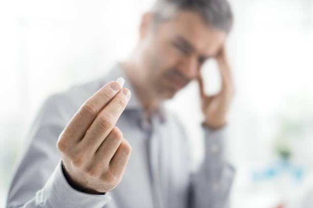 Stressed man with headache stock photo