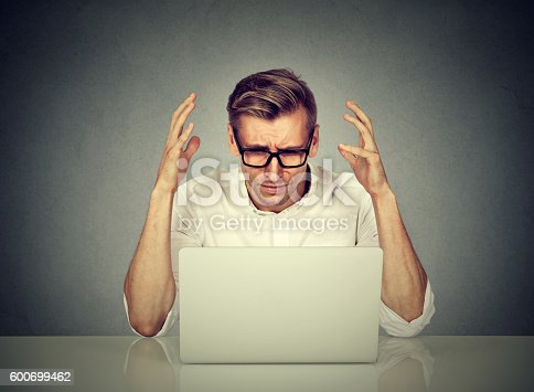 istock Stressed man working on computer. 600699462