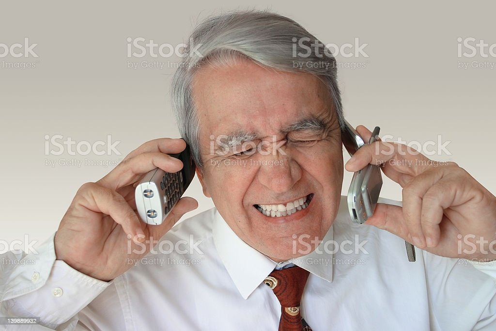 Stressed mature businessman stock photo