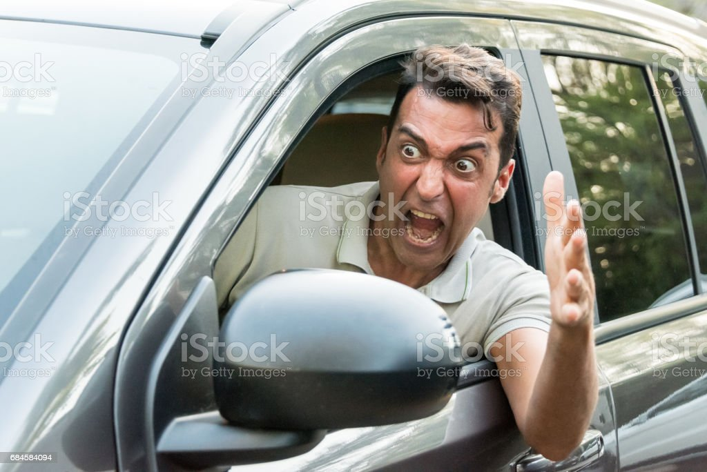 Stressed Mature man driving his car stock photo