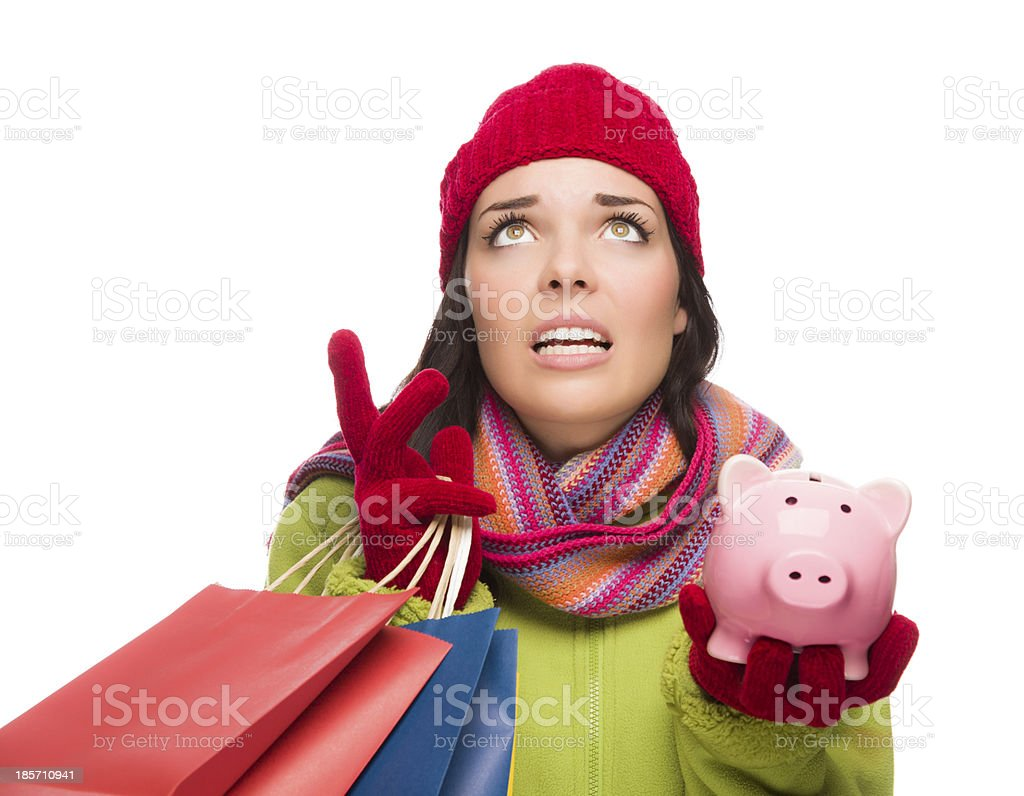 Stressed Mixed Race Woman Holding Shopping Bags and Piggy Bank stock photo