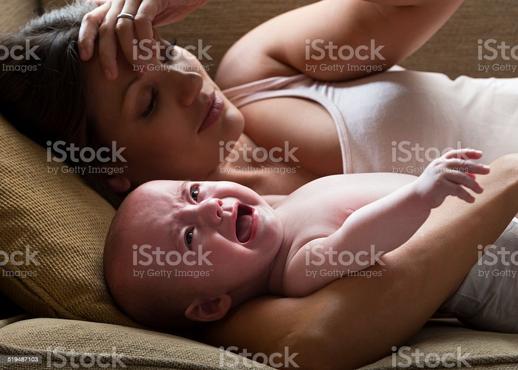 Stressed Mother and Her Baby stock photo