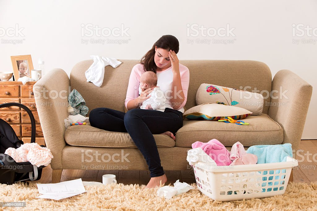 Stressed Mother with Baby stock photo
