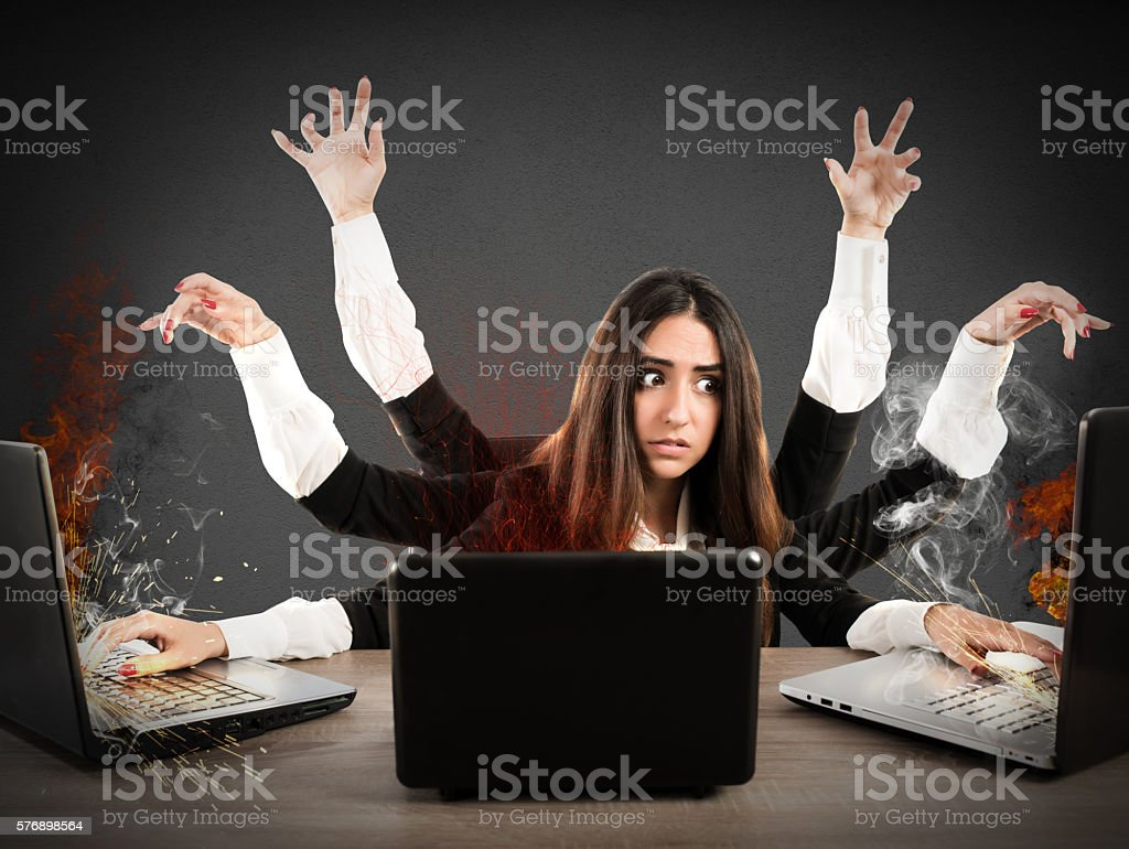 Stressed multitasking secretary stock photo