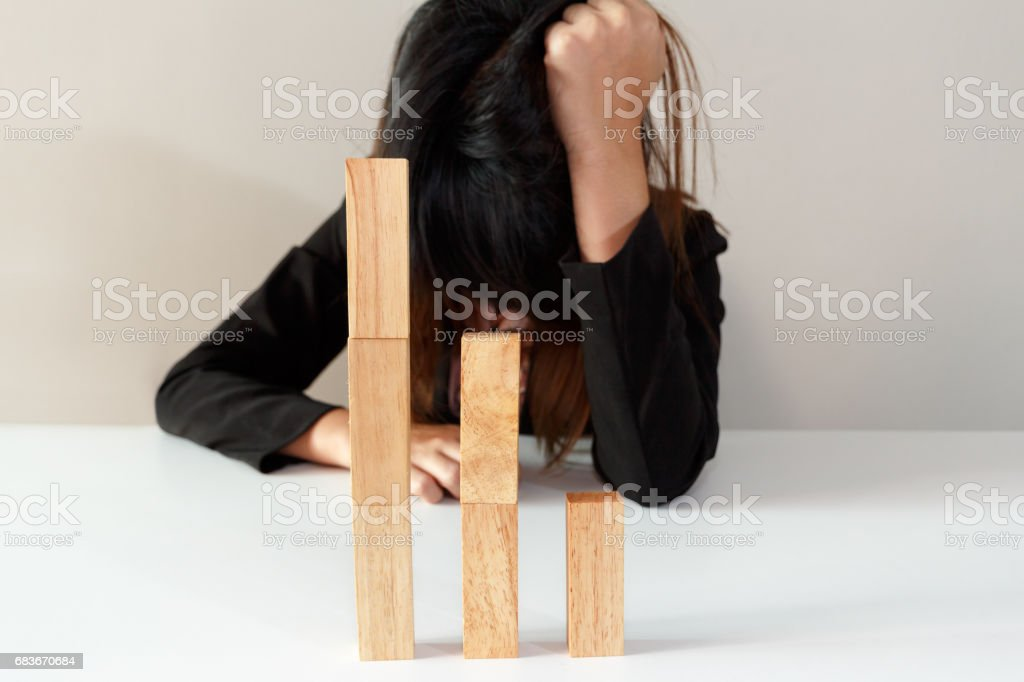 Stressed or sad businesswoman with simulate stock market took a nosedive. stock photo