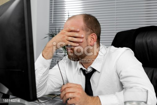 istock Stressed out businessman 155140216