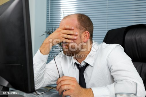 istock Stressed out businessman 157428866