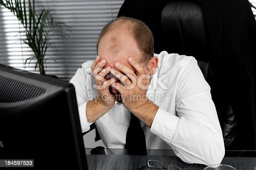 istock Stressed out businessman 184597533