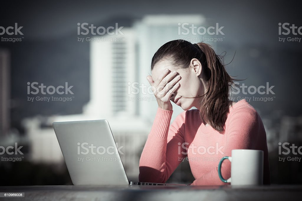 Stressed out businesswoman on her computer stock photo