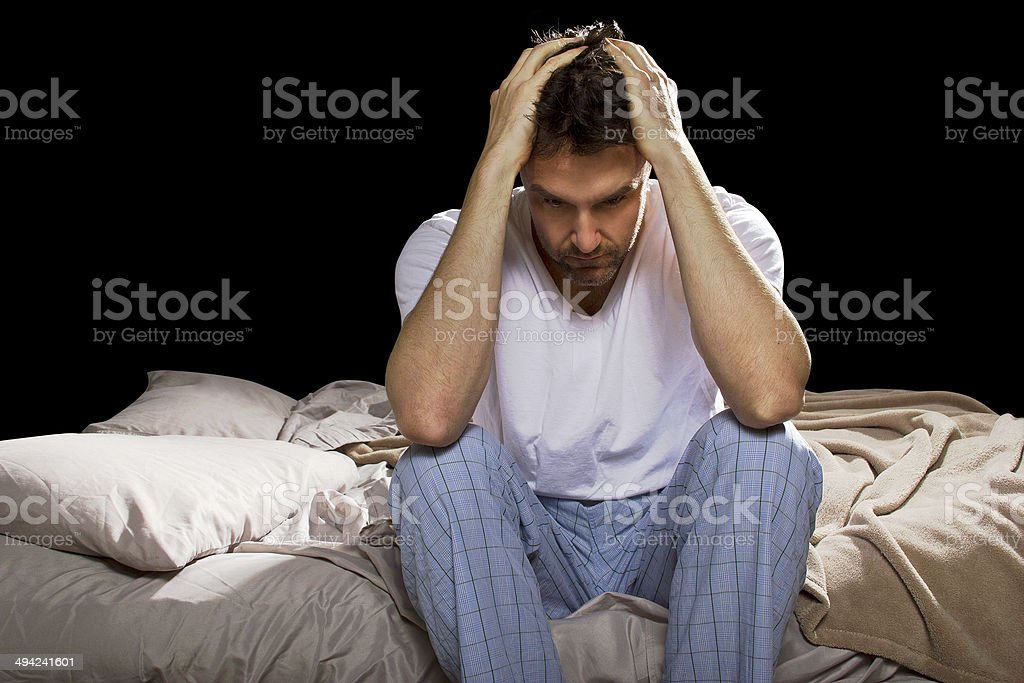 Stressed Out Man Staying Up Awake Suffering From Insomnia stock photo