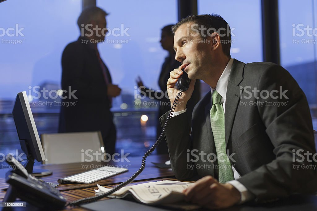 Stressed out Mature businesswman working late royalty-free stock photo