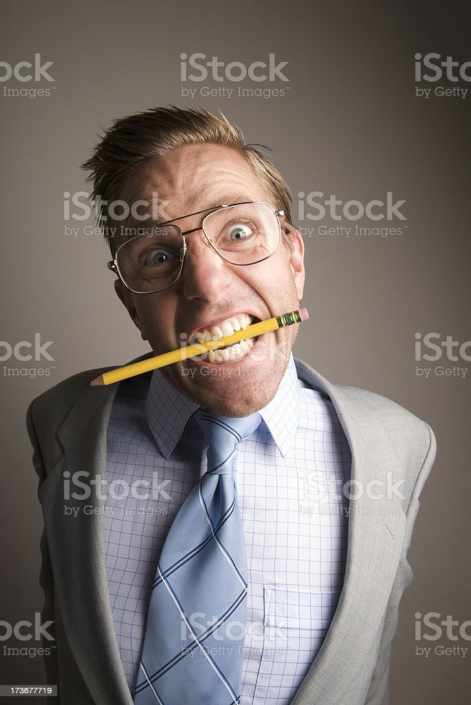 Stressed Out Nerdy Guy Chews Pencil royalty-free stock photo
