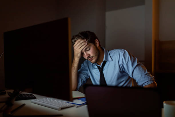 Stressed out working late stock photo