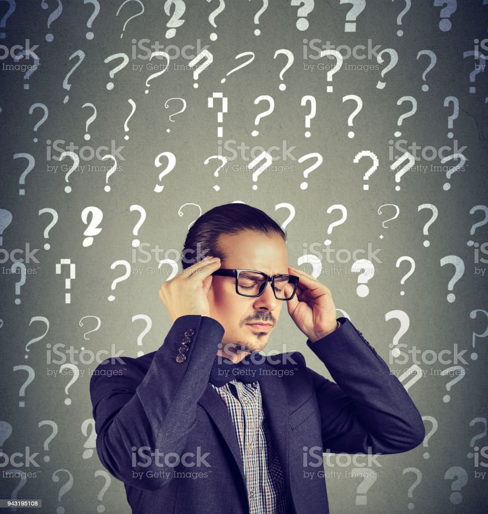 Stressed overburdened young man has too many questions stock photo