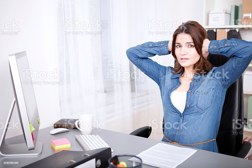 Stressed overworked young businesswoman stock photo