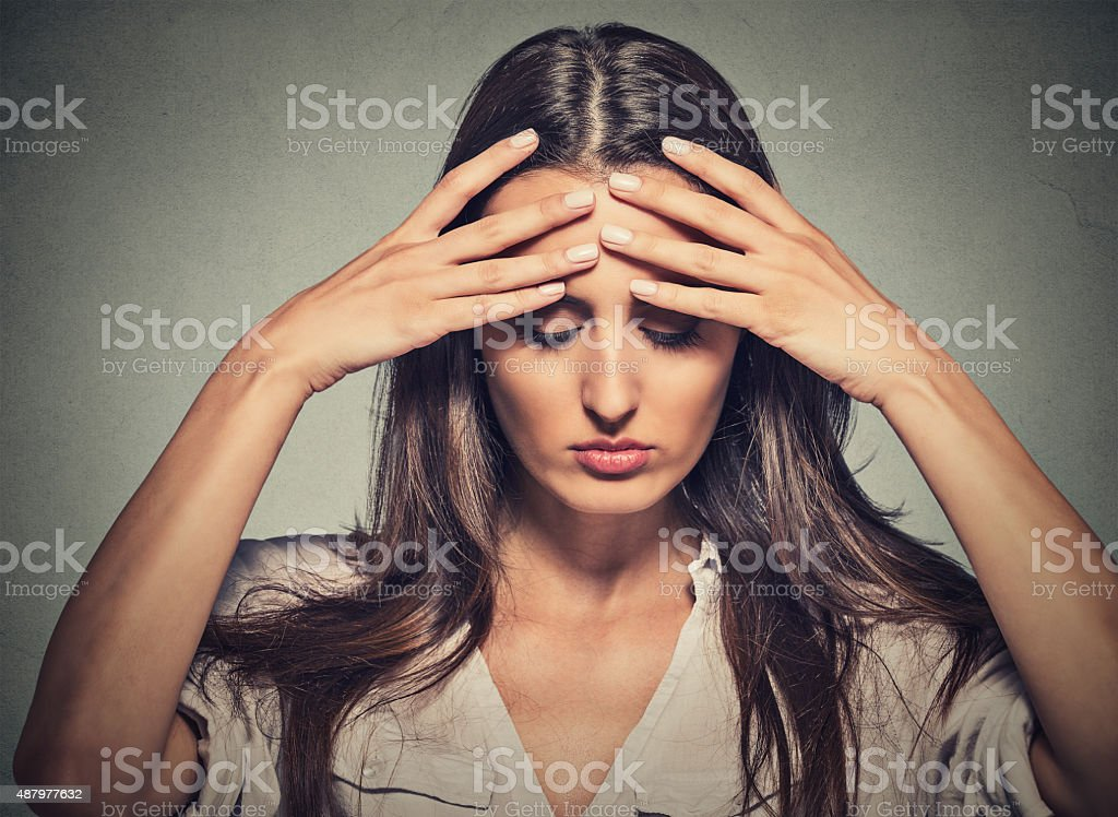 stressed sad woman with eyes closed having bad day stock photo