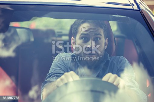 istock Stressed scared young man driver. Inexperienced anxious motorist concept 664857736