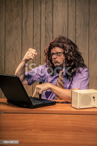 618210072 istock photo Stressed Shaggy Looking Computer Guy Working in Retro Office 155439202