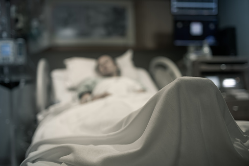 Stressed Sick Woman Lying In Hospital Bed Getting Medical Treatment Stock Photo - Download Image Now