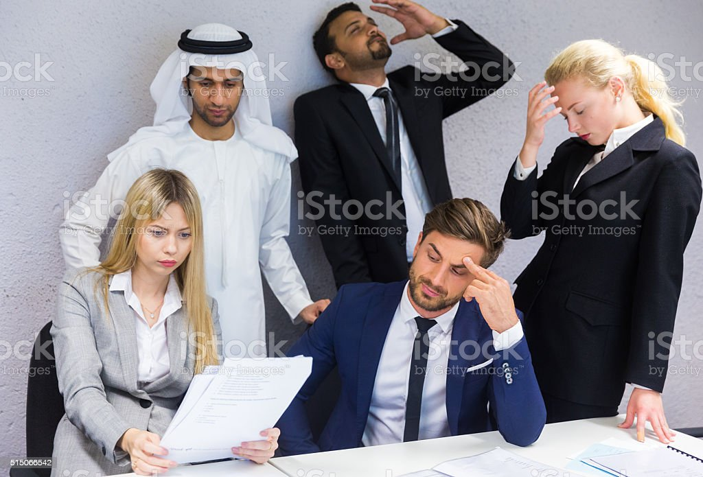 Stressed Staff in a Meeting Room stock photo