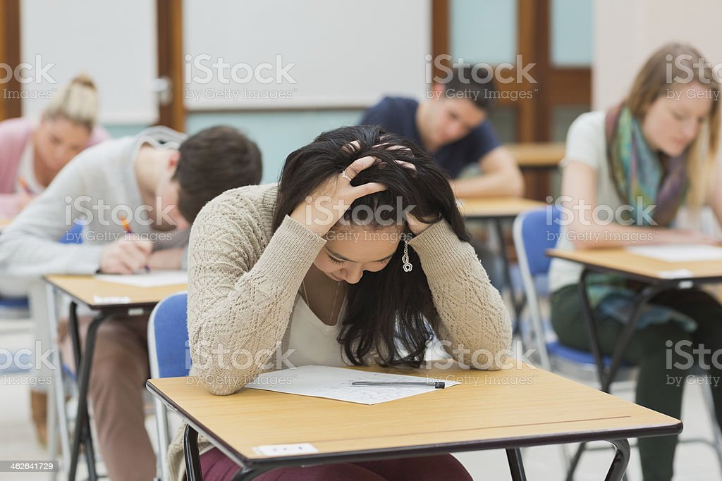 Stressed student doing a test stock photo