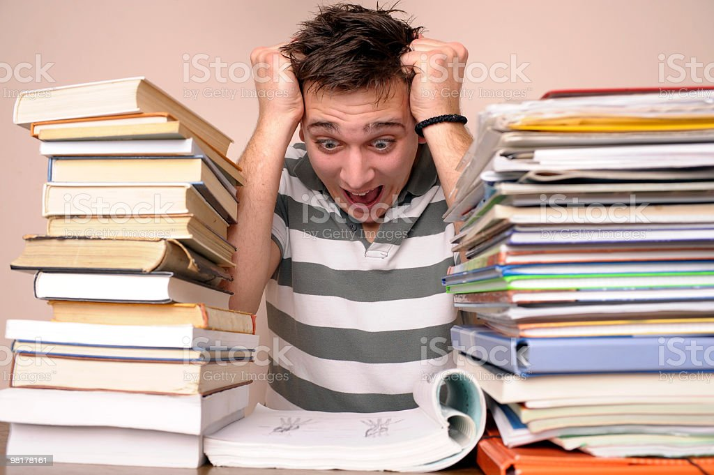 Stressed student with books royalty-free stock photo