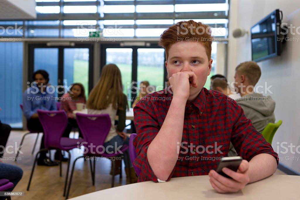 Подчеркнул студент с отделением для смартфона стоковое фото