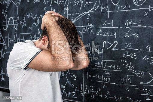 840623324istockphoto stressed teacher portrait 1002031294