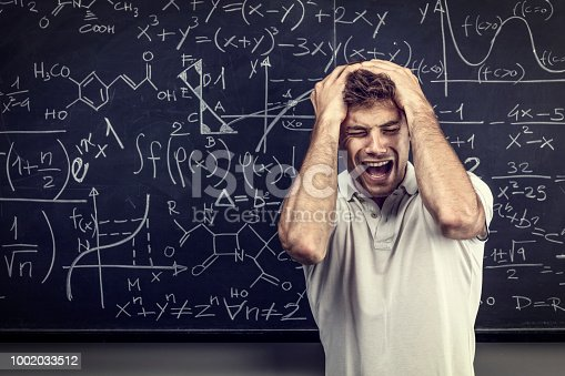 840623324istockphoto stressed teacher portrait 1002033512