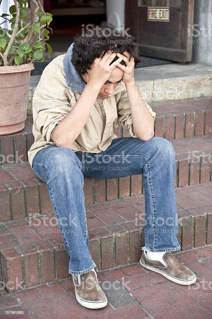 Stressed teenage boy stock photo