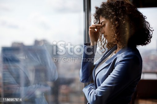 Stressed tired businesswoman