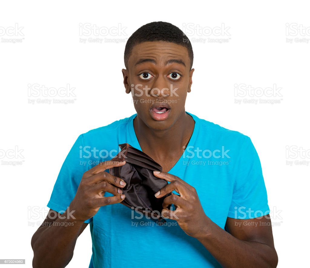stressed, upset, sad, unhappy young man standing with, holding, showing empty wallet stock photo