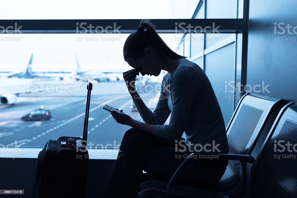 Stressed woman at the airport stock photo