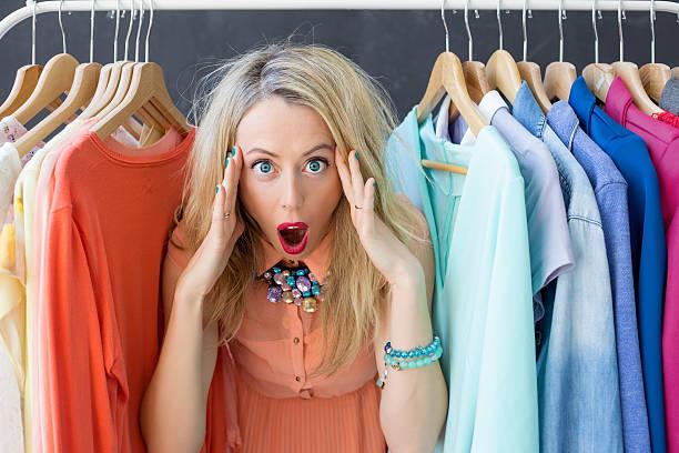 stressed woman deciding what to wear - kleiderschrank ohne türen stock-fotos und bilder