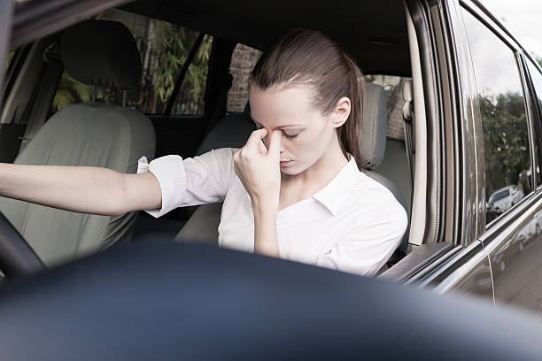 Stressed woman driver Transportation concept - Stressed woman driver. driving test nerves stock pictures, royalty-free photos & images