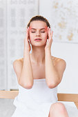istock Stressed woman has a strong headache. Close up portrait of beautiful girl suffering from head migraine. Feeling pressure and stress. 1207331301