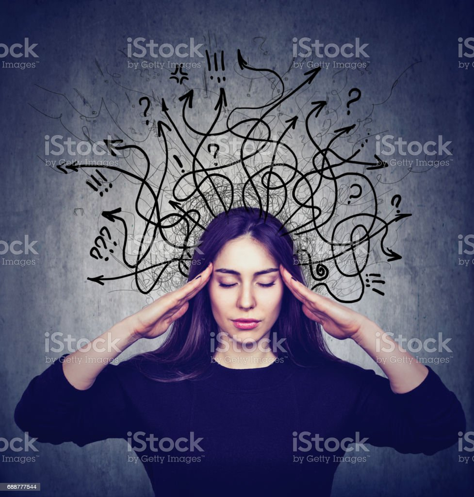 Stressed woman has too many thoughts stock photo