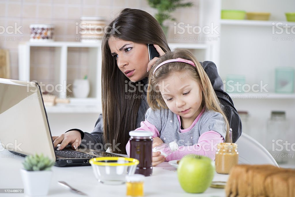 Stressed woman on the phone sitting with young girl royalty-free stock photo