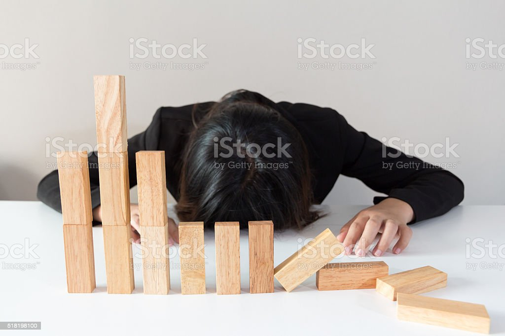 Stressed woman with simulate stock market took a nosedive stock photo