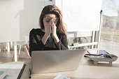 Stressed woman working in the office