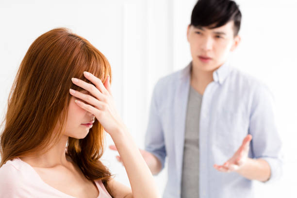 stressed young asian couple quarreling stressed young asian couple quarreling asian couple arguing stock pictures, royalty-free photos & images