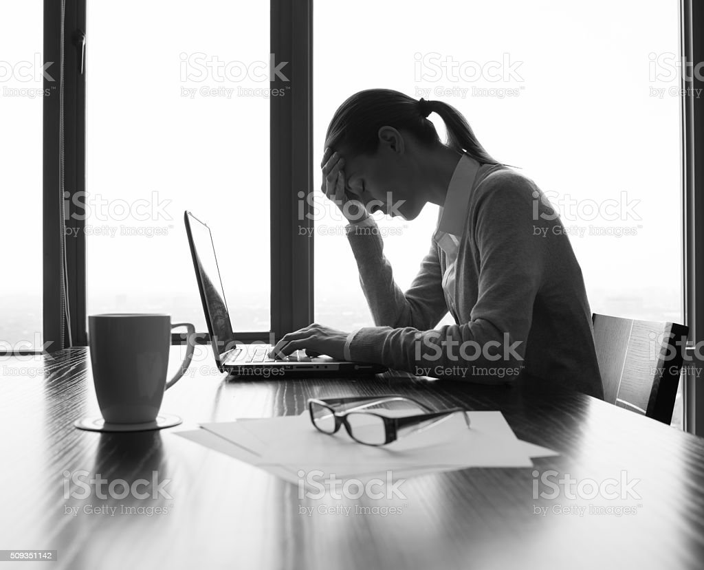Stressed young business woman stock photo